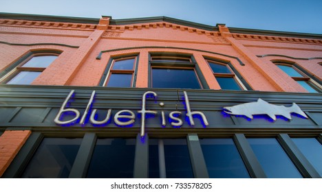Manistee, Michigan, USA - September 30, 2017: Façade an logo for the popular Bluefish restaurant on the waterfront of downtown Manistee Michigan.