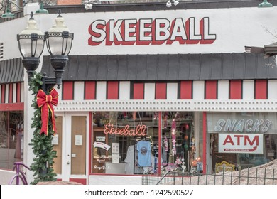 Manitou Springs, CO / USA - November 25, 2018: Vintage skeeball located in the famous Penny Arcade decorated for the holiday season.
