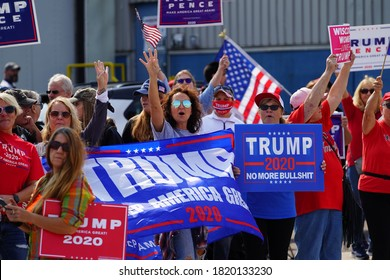 Manitowoc, Wisconsin / USA - September 21th, 2020: President trump and vice president mike pence supporters and joe biden and kamala harris supporters rallied together outside aluminum foundry.