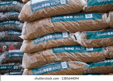 Mankato, MN/USA - Mar 5 2019 Bags of mulch sit in a pile waiting for the spring planting in an illustrative editorial photo.