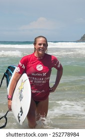 MANLY AUSTRALIA - FEBRUARY 15: Happy Laura Enever leaving water after  the competition among women in the Australian Surfing Open at Manly Beach. February 15, 2015 Manly, Australia.