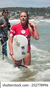 MANLY AUSTRALIA - FEBRUARY 15: Laura Enever leaving water after  the competition among women in the Australian Surfing Open at Manly Beach. February 15, 2015 Manly, Australia.