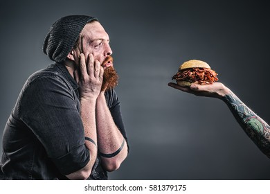 Manly bacon lover with a red beard being tempted