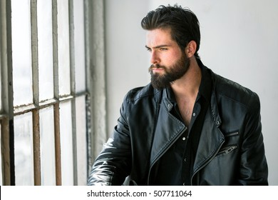 Manly male with full beard tall dark handsome strong tough serious intense bad boy biker