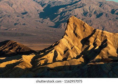 Manly Peak at Zabriskie Point and badlands in Death Valley National Park on a early morning of summer, California, USA.