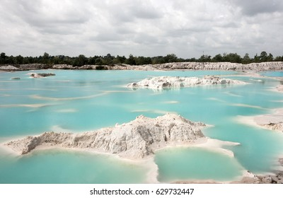 Man-made artificial lake Kaolin, turned from mining ground holes. Due to mining, holes were formed covered by rain water, forming a clear blue lake, Air Raya Village, Tanjung Pandan, Belitung Island.