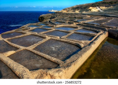 Manmade salt pools on a Gozo coastline
