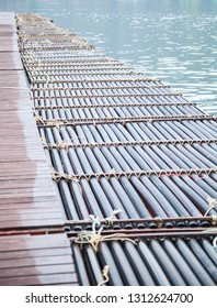 manmade synthetic plastic pipe floating pontoon for supporting a variety of marina dock systems including harbors, flotation docks, rafts over water background. Floating Structure Material concept.