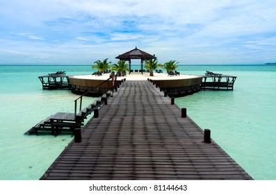 A man-made walkway Kapalai island with exotic tropical resort
