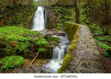 Manmade water cascade encountered in a small village call Brazasti. Photo taken on 1st of May 2021 in Brazasti village, Baia de Aries, Alba county, Romania.