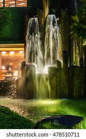 Man-made waterfall with backlight in Nan Lian Garden at Diamond Hill in Hong Kong