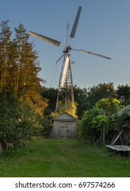 Manmade windmill near the forest