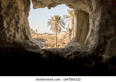 Man-made window from a hermit cave located next to the monastery of Gerasim Jordanian - Deir Hijleh - in the Judean desert near the city of Jericho in Israel