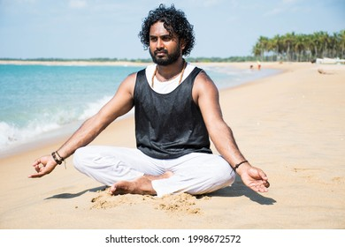 Mannar, Sri Lanka- January 12, 2019: Yoga teacher practice at beach in Mannar sri lanka
