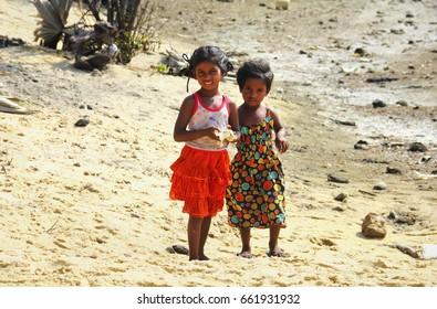 MANNAR/SRI LANKA - FEB 01: Two unidentified little girls walk on the wild beach and pose for a photo on February 01, 2017 in Talaimannar, Mannar island, Sri Lanka, South Asia.