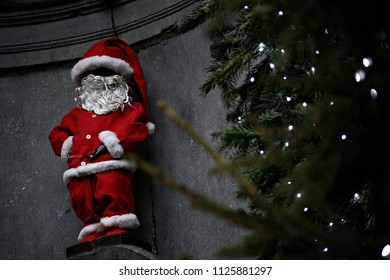 Manneken Pis fountain dressed like Santa Claus in Brussels, Belgium on Dec. 25, 2016. This bronze statue of just 30 centimeters of naked boy peeing in a fountain is the symbol of the city.