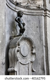 Manneken Pis, also known in French as the Petit Julien. Famous statue of peeing boy in Brussels, Belgium.