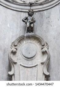 Manneken Pis (Little man Pee) or le Petit Julien, a landmark small bronze sculpture in Brussels, Belgium