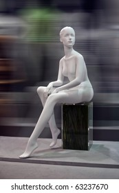 Mannequin before a  blur background , no clothes, Dummy.