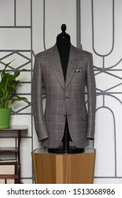 Mannequin with bespoke checkered jacket in atelier