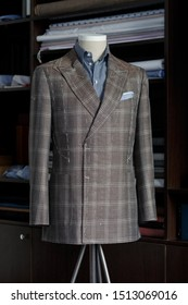 Mannequin with bespoke checkered jacket and striped shirt in atelier