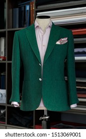 Mannequin with bespoke green jacket in atelier