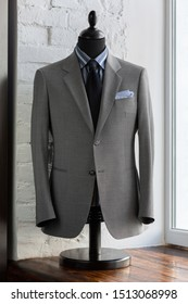 Mannequin with bespoke grey jacket in atelier