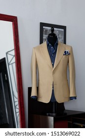 Mannequin with bespoke ivory jacket in atelier