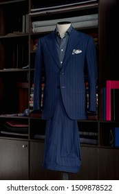 Mannequin with bespoke navy blue suit in atelier