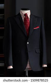Mannequin with bespoke suit, red tie and checkered shirt in atelier