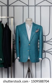 Mannequin with bespoke turquoise jacket in atelier