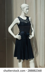 mannequin with a blue dress in a showroom