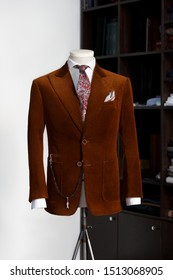 Mannequin with brown corduroy bespoke jacket and tie in atelier