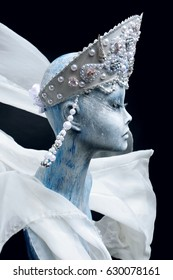 Mannequin in creative  crown and white  cloth