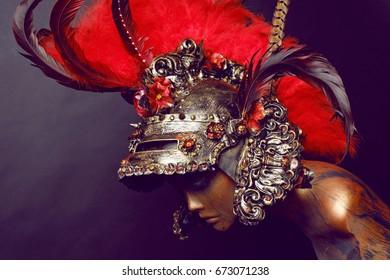 mannequin in creative helmet with plume