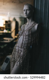 Mannequin doll portrait in a workshop.