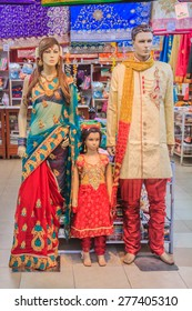 Mannequin family dressed in traditional Indian colorful clothing at the sari street market in Penang, Malaysia