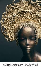 Mannequin in golden head wear