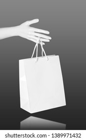 Mannequin Hand with blank shopping bag. Mock up. Sale shopping concept