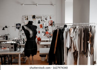 Mannequin and hangers with development materials. Design, studio for sewing and cutting clothes, designer clothes, manufacturing, craft product.