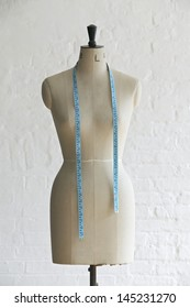 Mannequin with hanging measuring tape indoors