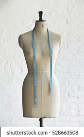 Mannequin with hanging measuring tape, indoors