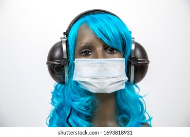 a mannequin head with blue hair and headphones wearing face mask for protection from viruses