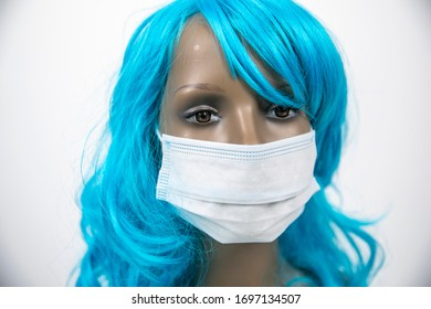 a mannequin head with blue hair wearing face mask for protection from viruses