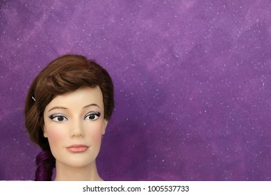Mannequin head on a purple background