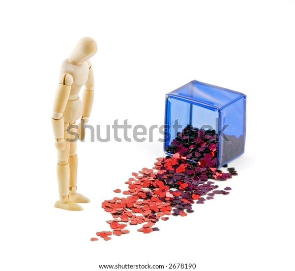 Mannequin looks at mess of hearts from spilled blue box