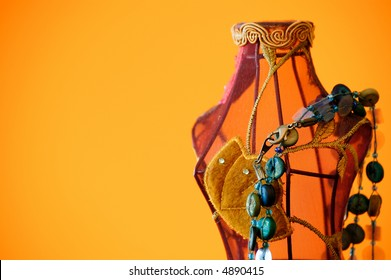 mannequin made of wire and clothes with blue necklace.