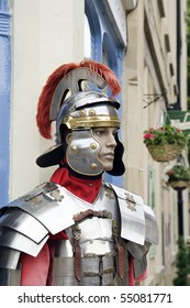 a mannequin or model of a roman soldier dresses in armour