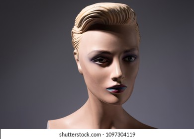 mannequin portrait of woman without arms and with lips painted b