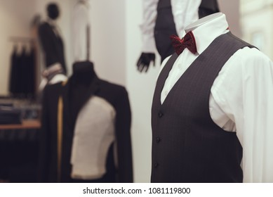 Mannequin in shirt, waistcoat and bow tie is in business style shop. Dressing room. Boutique of business suits. New suit purchase.